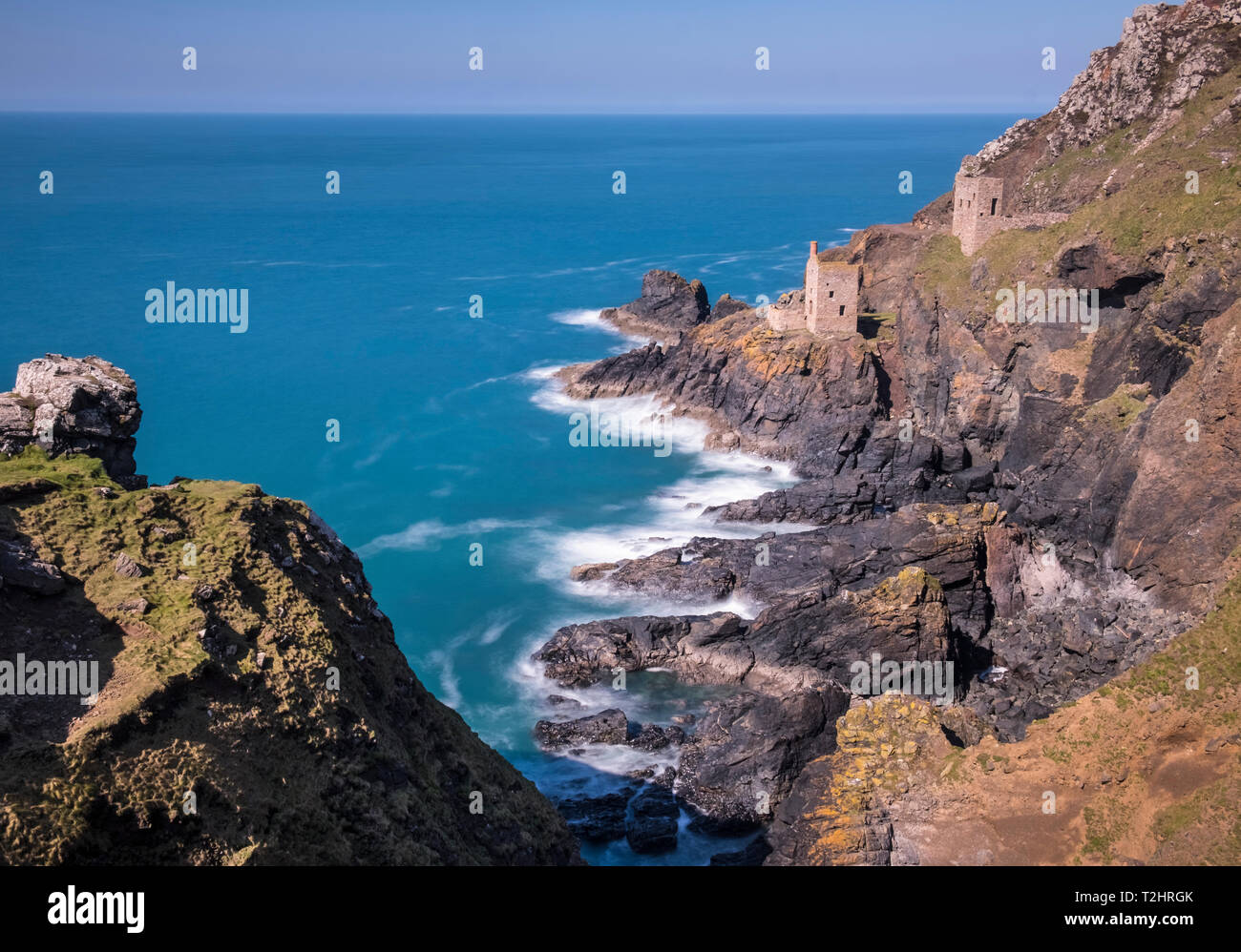 Disused tin mine buildings on dramatic cliff edges of north Atlantic coast, Botallack, Cornwall, England, UK Stock Photo