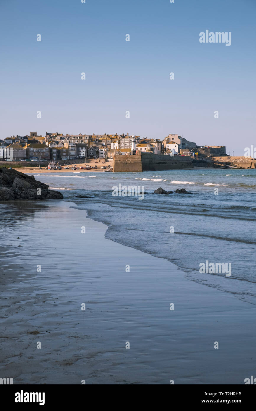 St Ives harbour on a bright sunny March day, viewed from Porthminster Beach, Cornwall, England, UK Stock Photo
