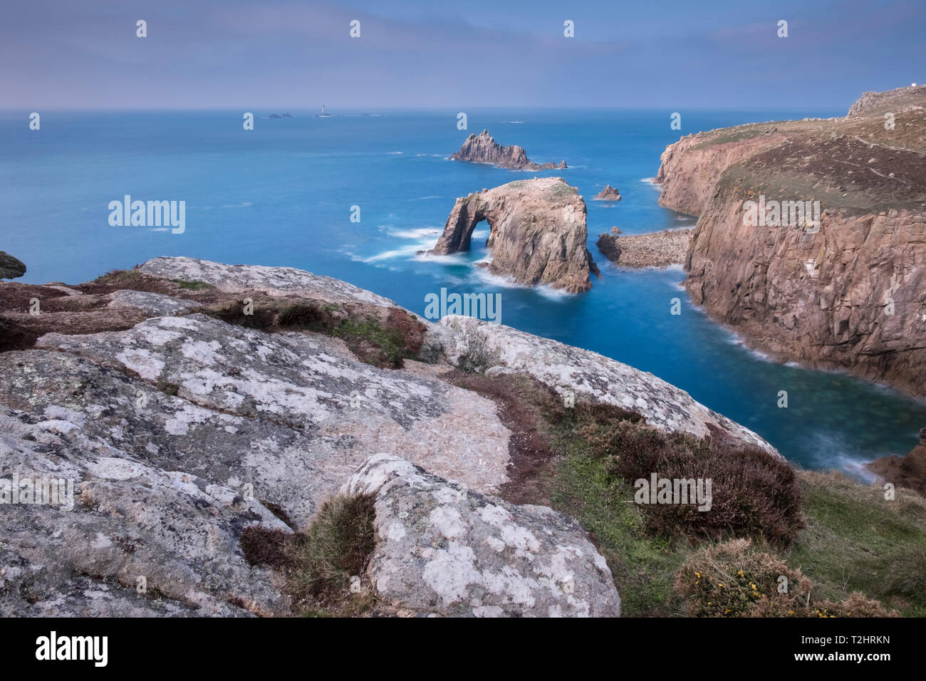 Dramatic cliffs, sea stacks and Enys Dodnan arch on the rugged north Atlantic coast, Lands End, Cornwall, UK Stock Photo