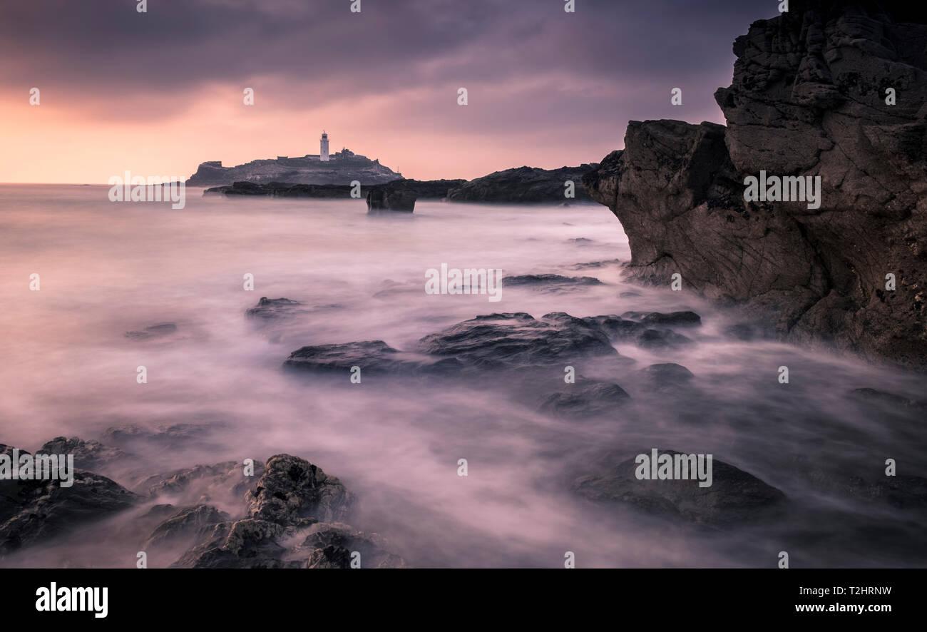 Sunset at Godrevy Point Lighthouse, on the north Atlantic coast of Cornwall, England, UK. Stock Photo