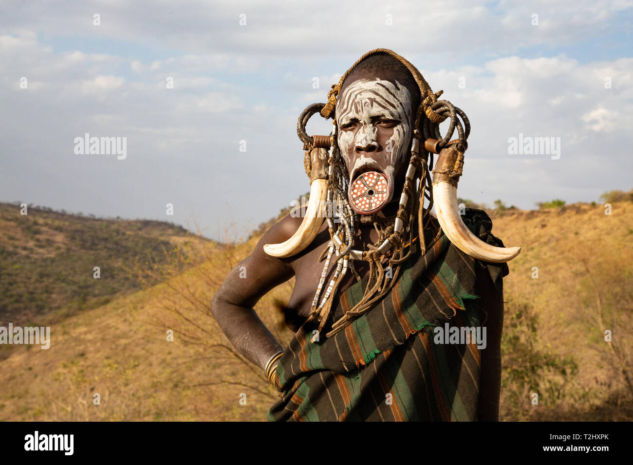 A decorated Mursi woman in Mago National Park, southern Ethiopia - Stock Image