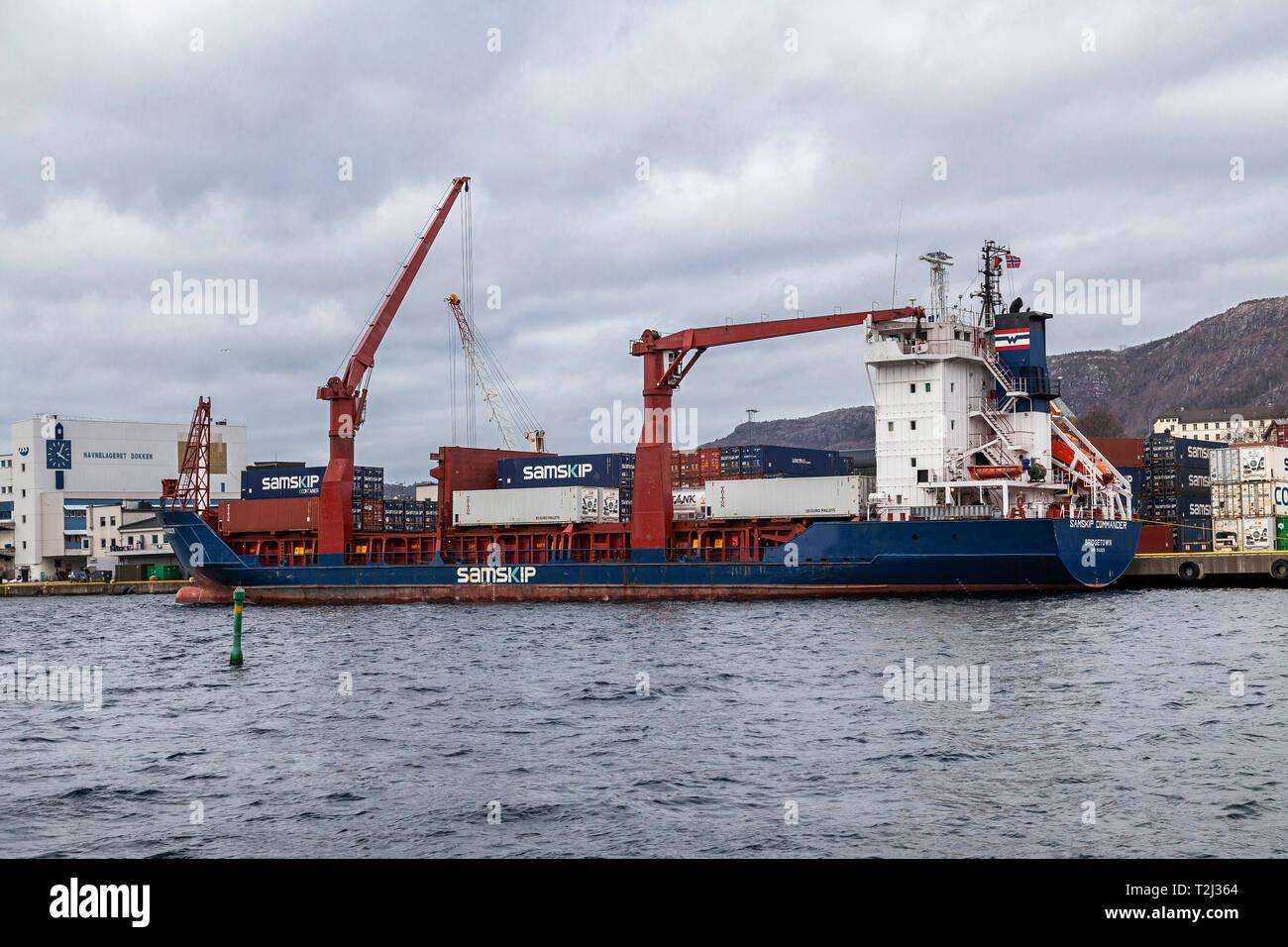 General cargo and container vessel Samskip Commander at work at Dokken terminal (Dokkeskjærskaien), in the port of Bergen, Norway. - Stock Image