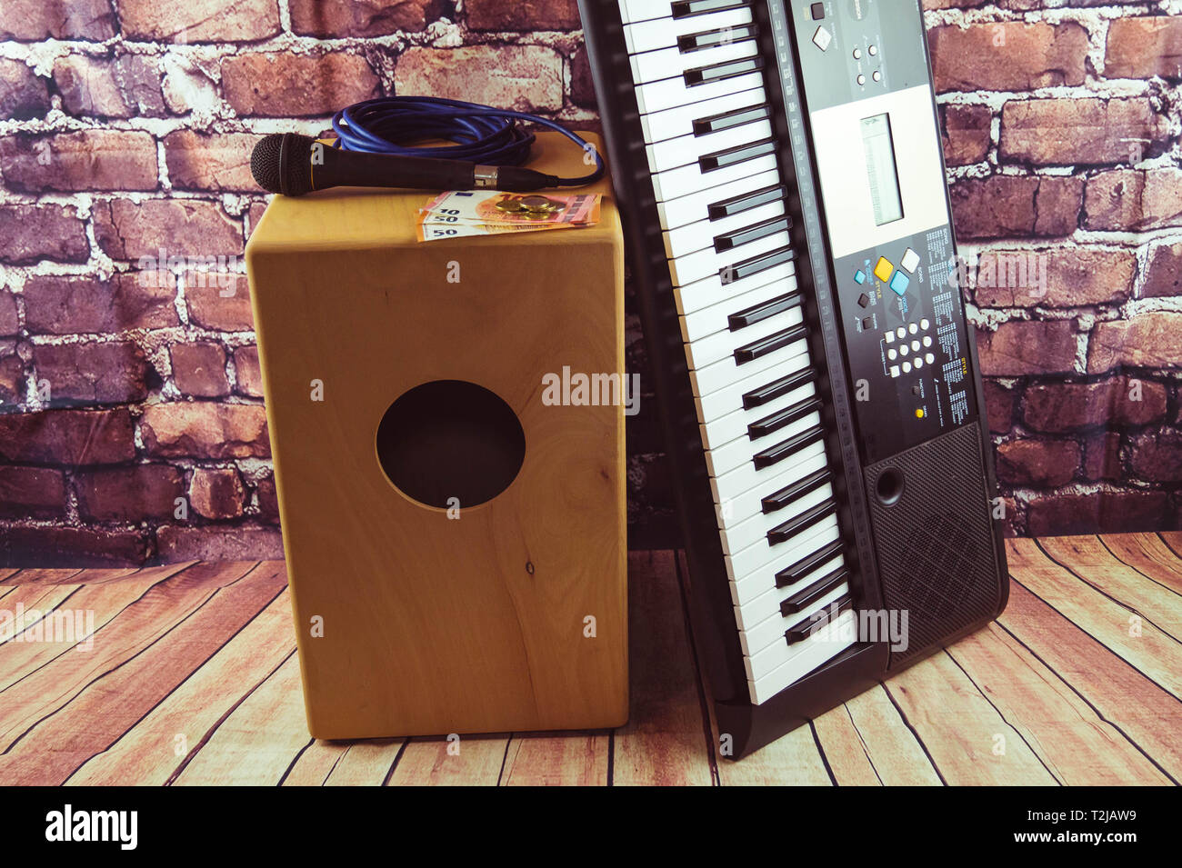Music Equipment like cajon Synthesizer and Microphone - Stock Image