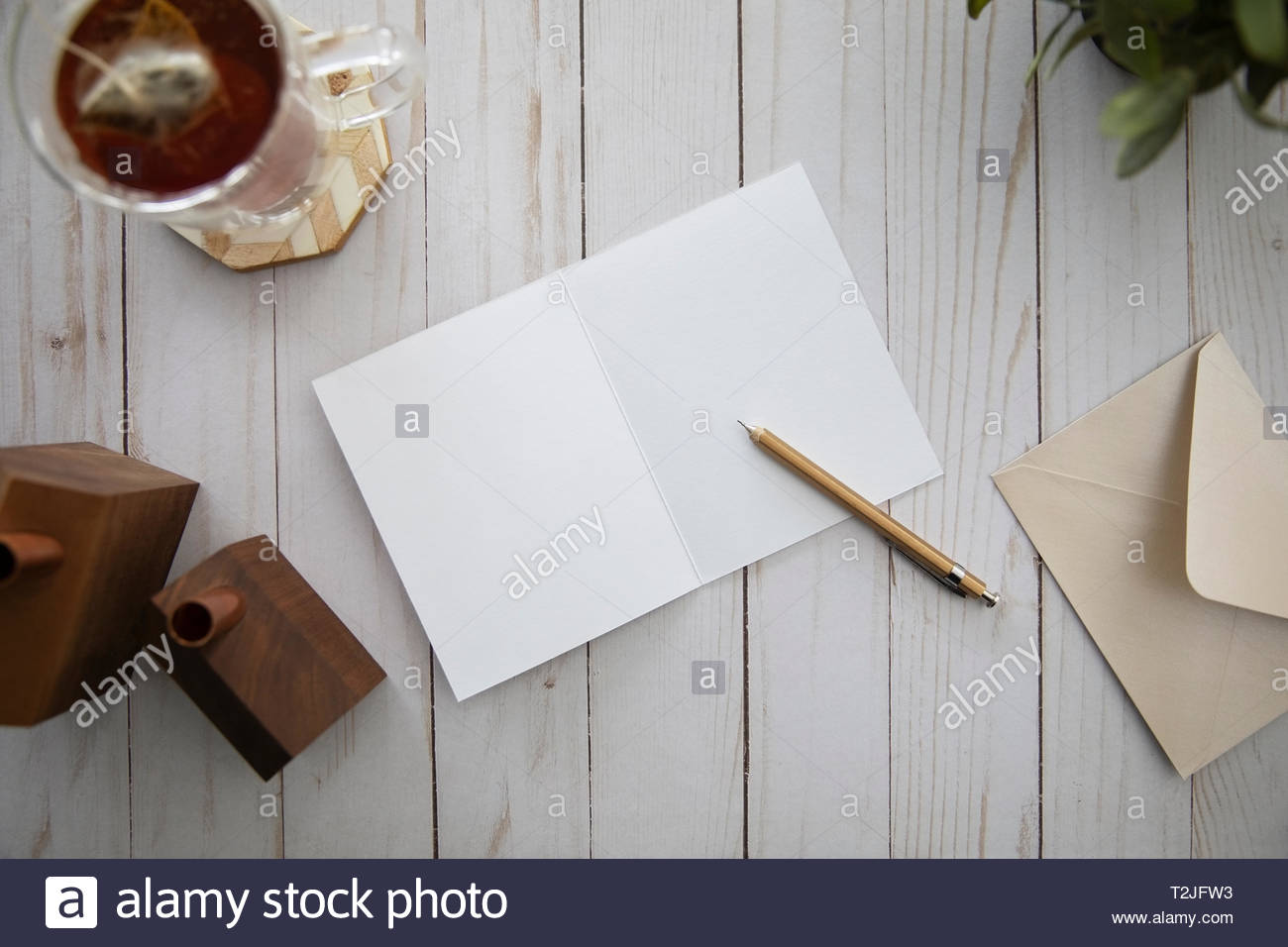 View from above letter writing with tea - Stock Image
