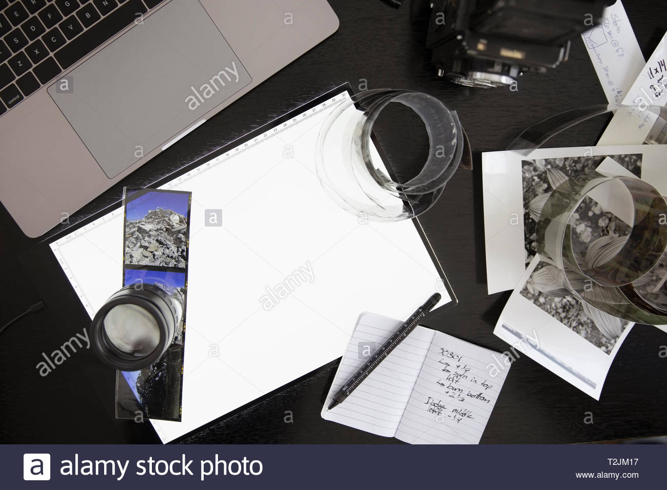 View from above photography light table and negatives on desk - Stock Image