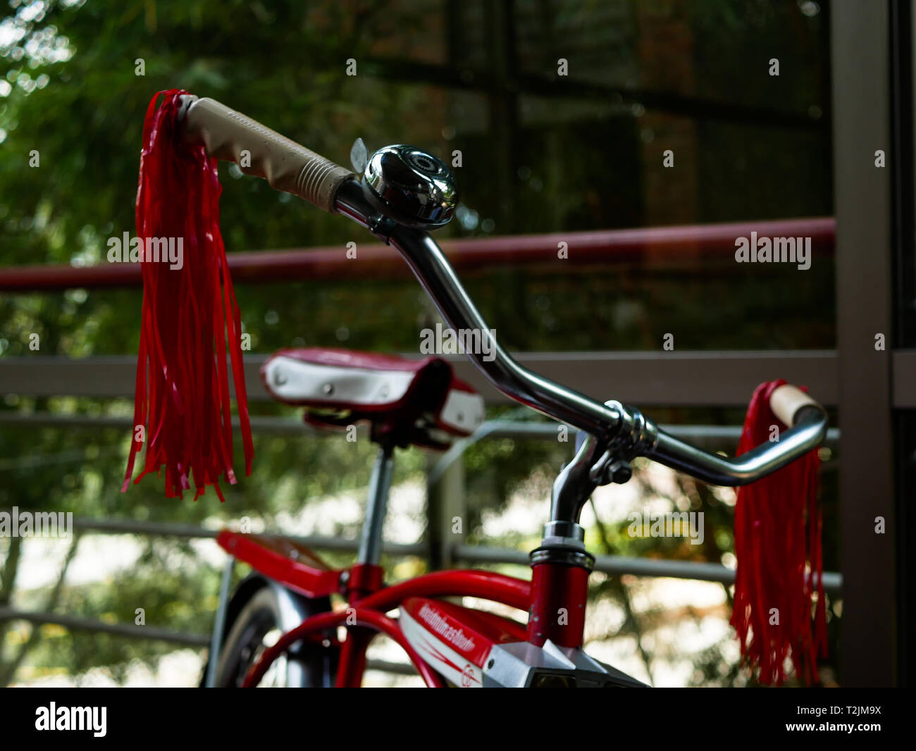 and old red bike on display during an expo on museo el castillo medellin colombia - Stock Image