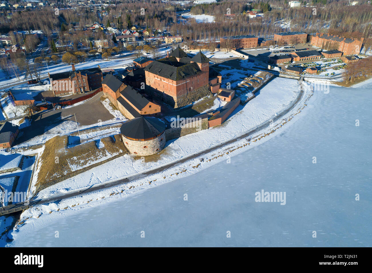 A view from the height of the ancient fortress-prison of the town of Hameenlinna on a sunny March day (aerial photography). Finland Stock Photo
