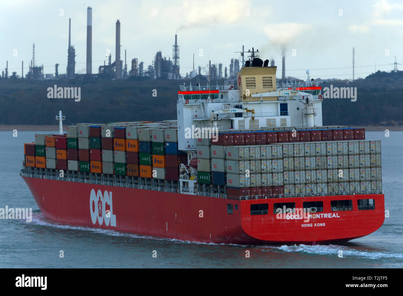 Container Ship,OOCL,Montreal,Fawley,Oil,Refinery,The Solent,Southampton,Port,Terminal,Cowes,isle of Wight,England,UK,box,boat Stock Photo