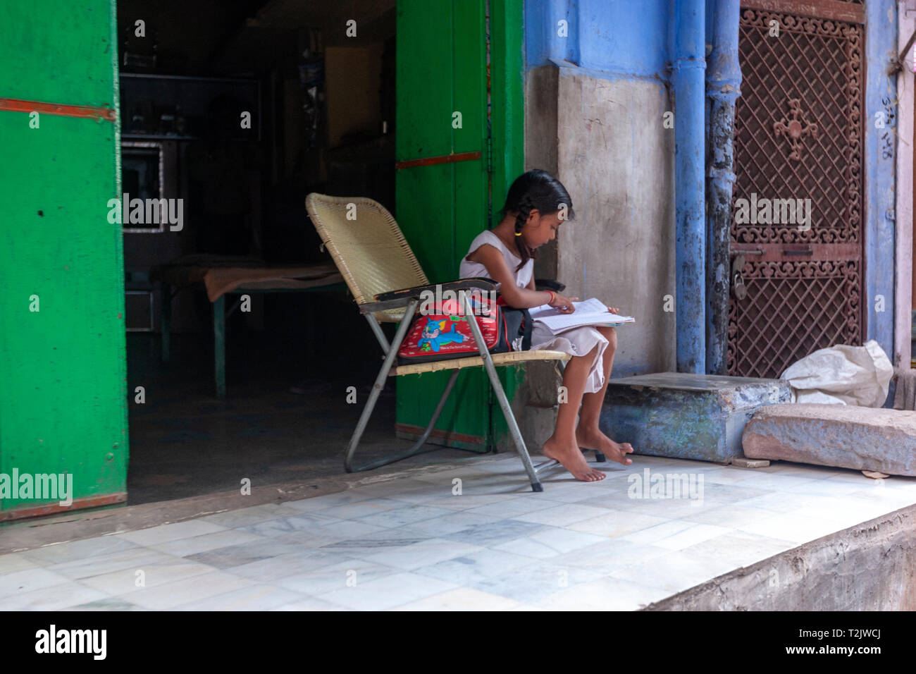 Young girls doing school task outside her house in Jodhpur, 	Rajasthan, India - Stock Image