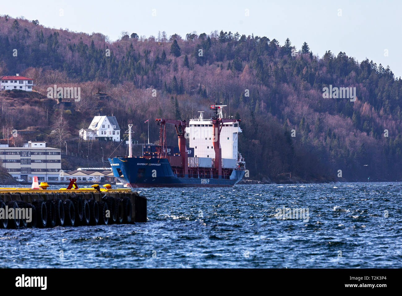 General cargo and container vessel Samskip Commander at sea, arriving in the port of Bergen, Norway. - Stock Image