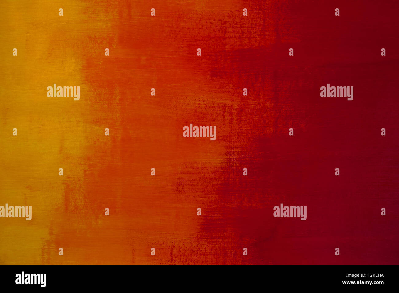 Minimalist paint texture background with warm tones - red, orange and yellow - Stock Image