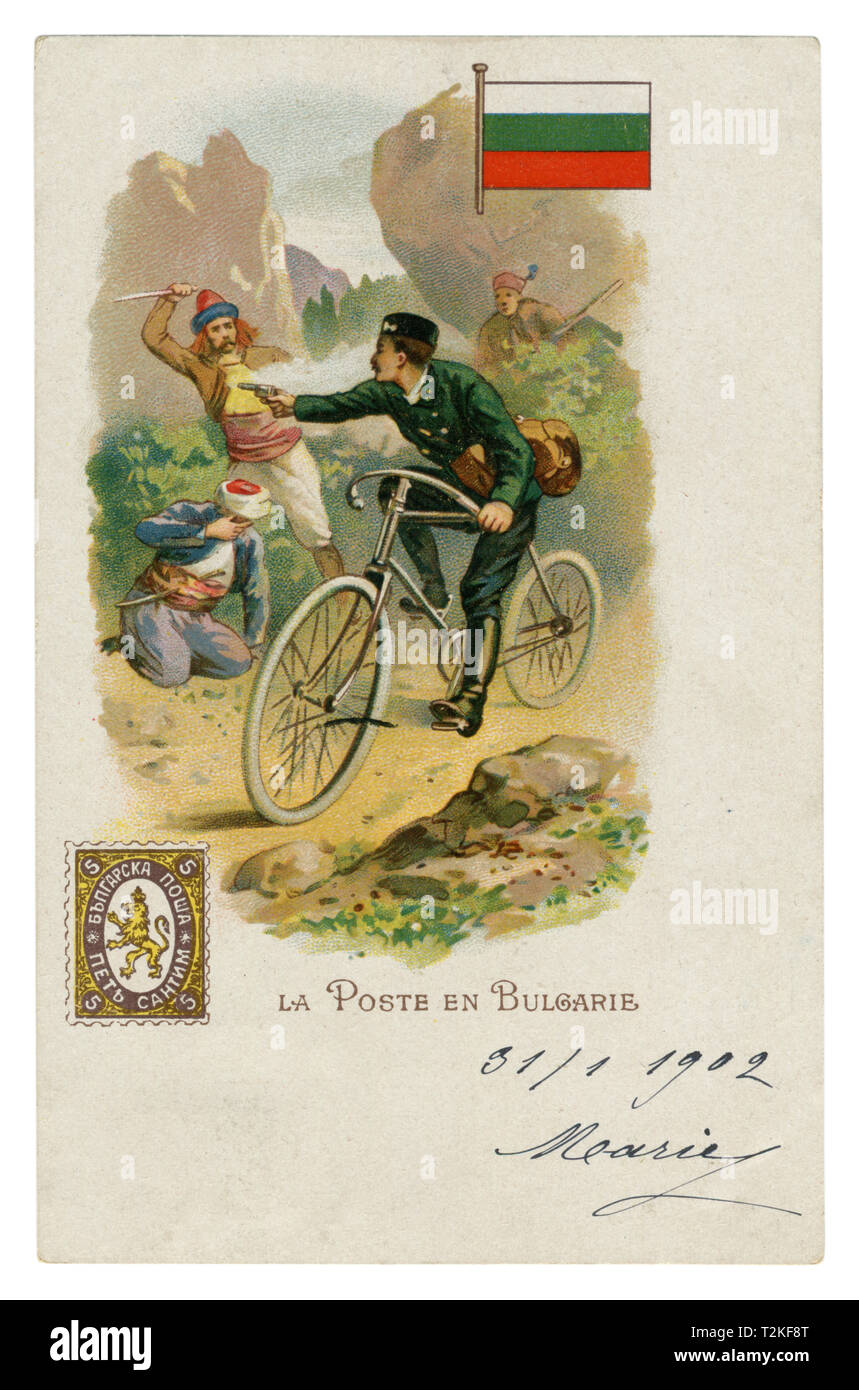 French historical chromolithographic postcard: World post series. Bulgarian post. Postman on a Bicycle shoots from the bandits. Flag and postage stamp - Stock Image
