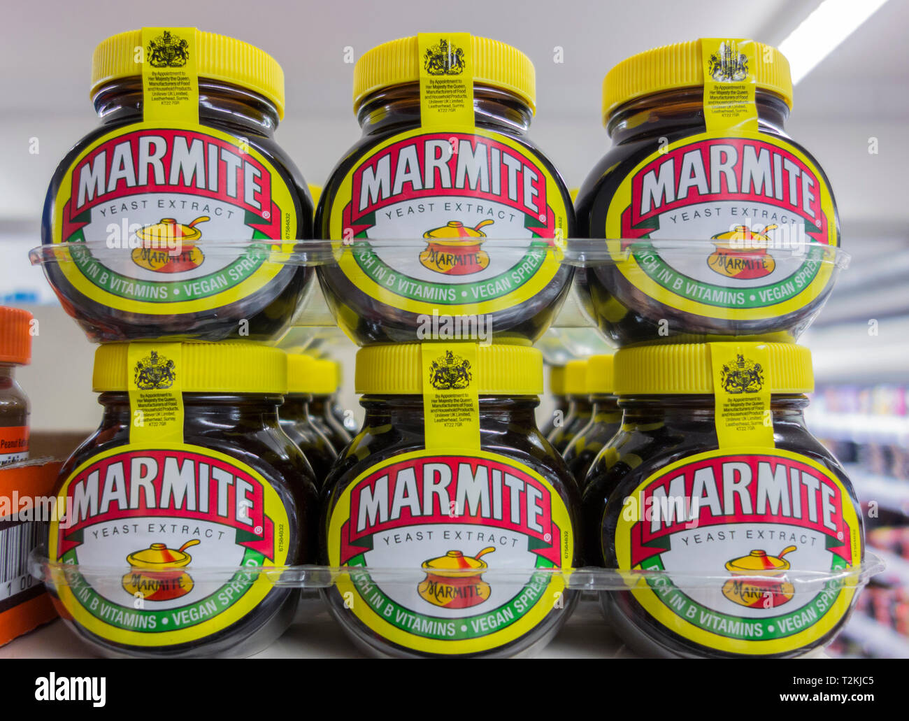 Jars of Marmite yeast extract stacked on a supermarket shelf in London, UK - Stock Image