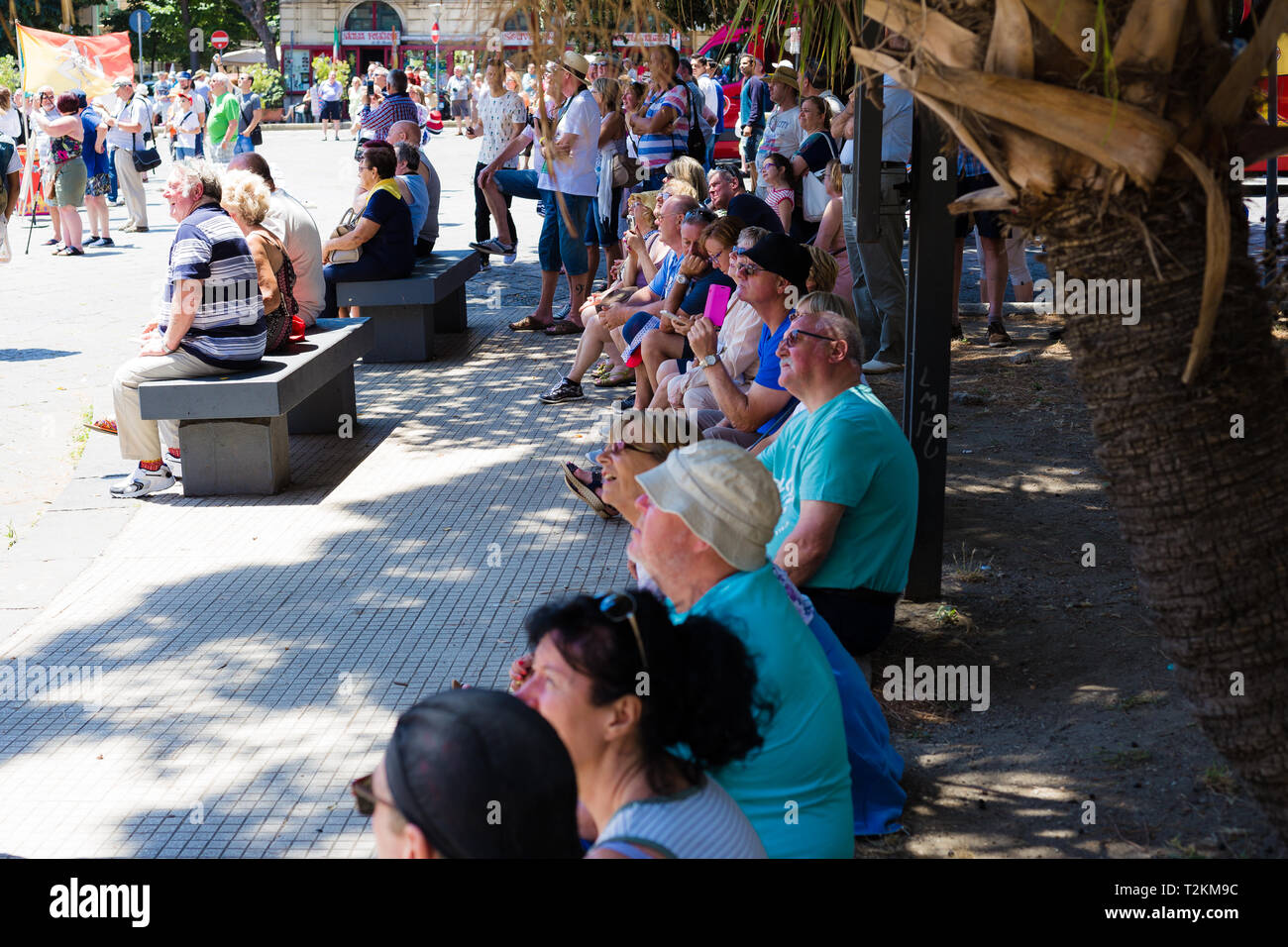 Messina, Sicily, Italy. People gather in the square waiting for the astronomical clock tower to chime. - Stock Image