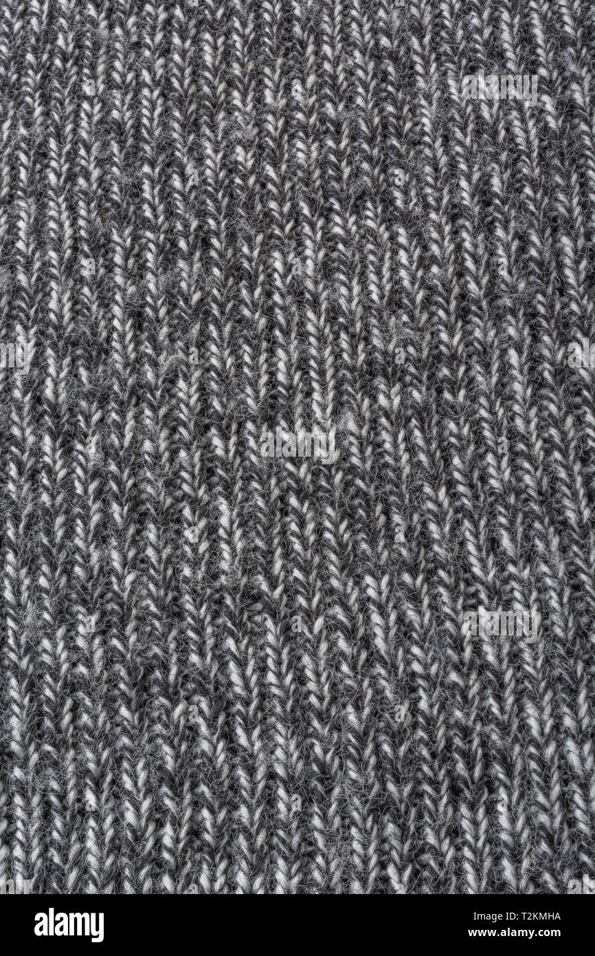 Close-up macro shot of woven polyester fabric. Metaphor stitched in time, stitched up, warp and weft, textile industry. - Stock Image