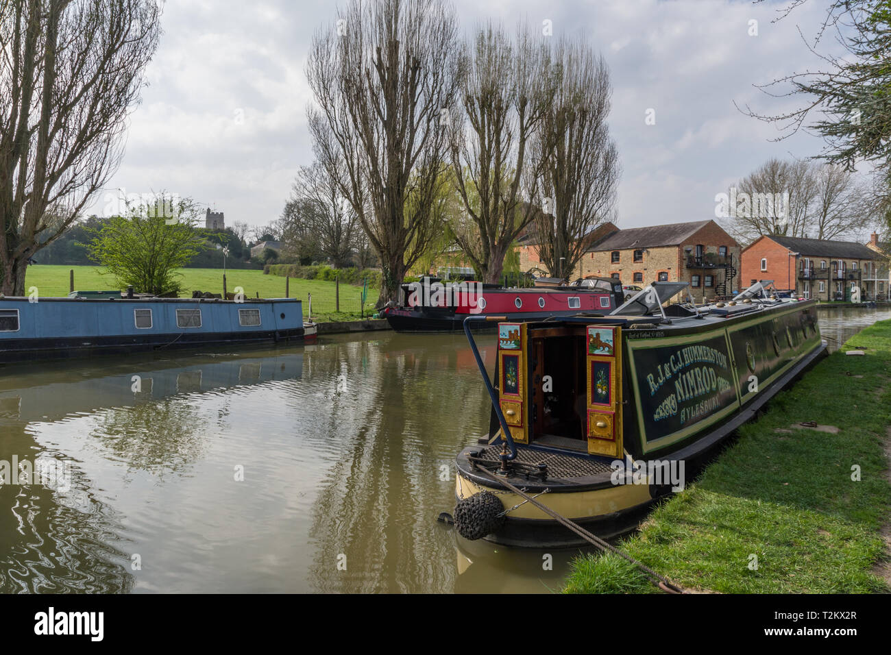 Narrowboats on the Grand Union canal in Spring, Cosgrove, Northamptonshire, UK - Stock Image