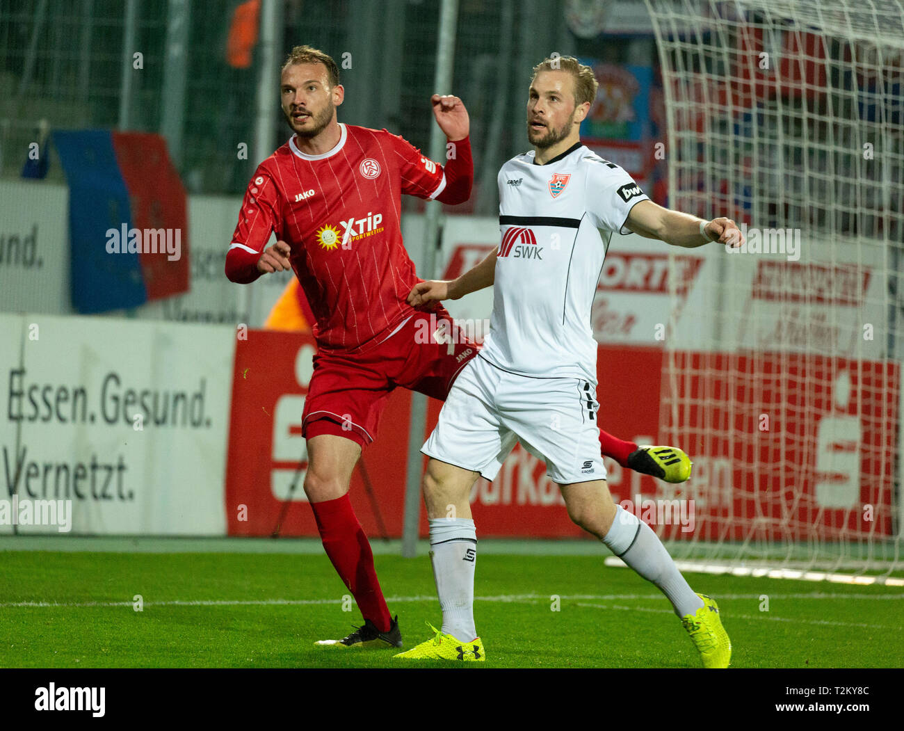 sports, football, Lower Rhine Cup, 2018/2019, semifinal, Rot Weiss Essen vs KFC Uerdingen 0-2, Stadium Essen, Hafenstrasse, scene of the match, Robin Urban (RWE) left and Maximilian Beister (KFC) Stock Photo