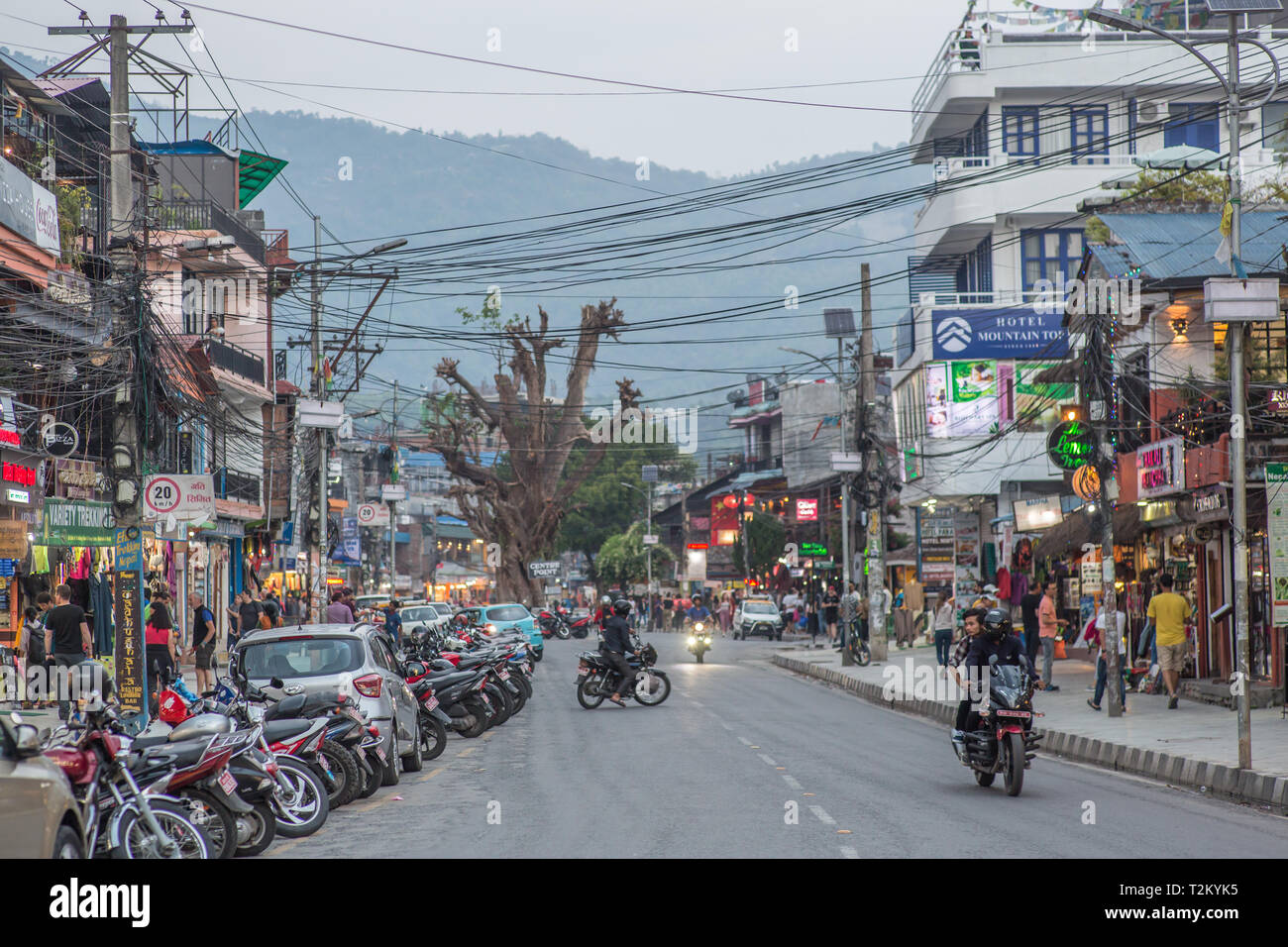 A calm road in Pokhara, Nepal on a cloudy afternoon. - Stock Image