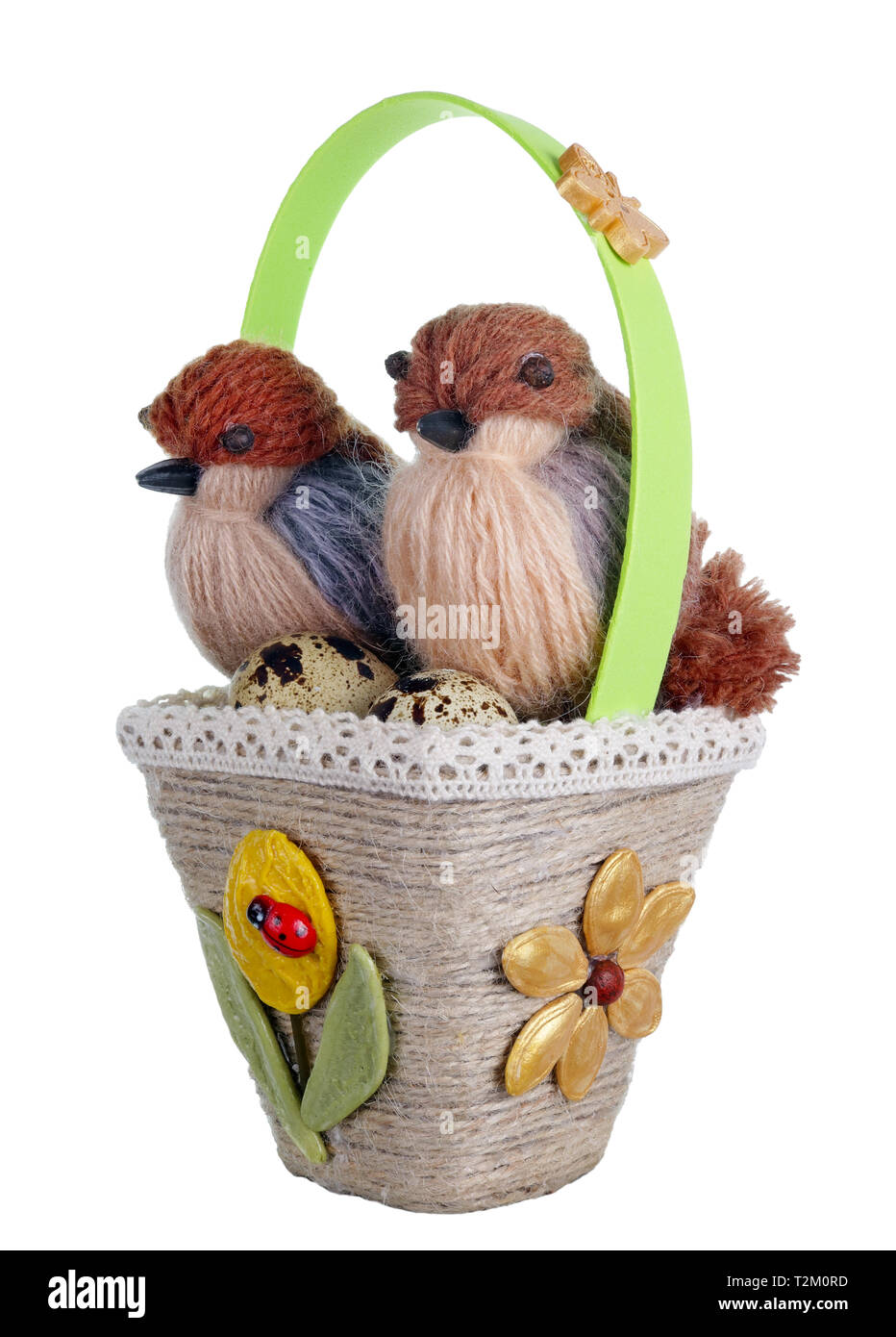 Easter handmade  basket nest from rope and pasta  with funny birds  and quail eggs. Isolated on white studio macro shot Stock Photo