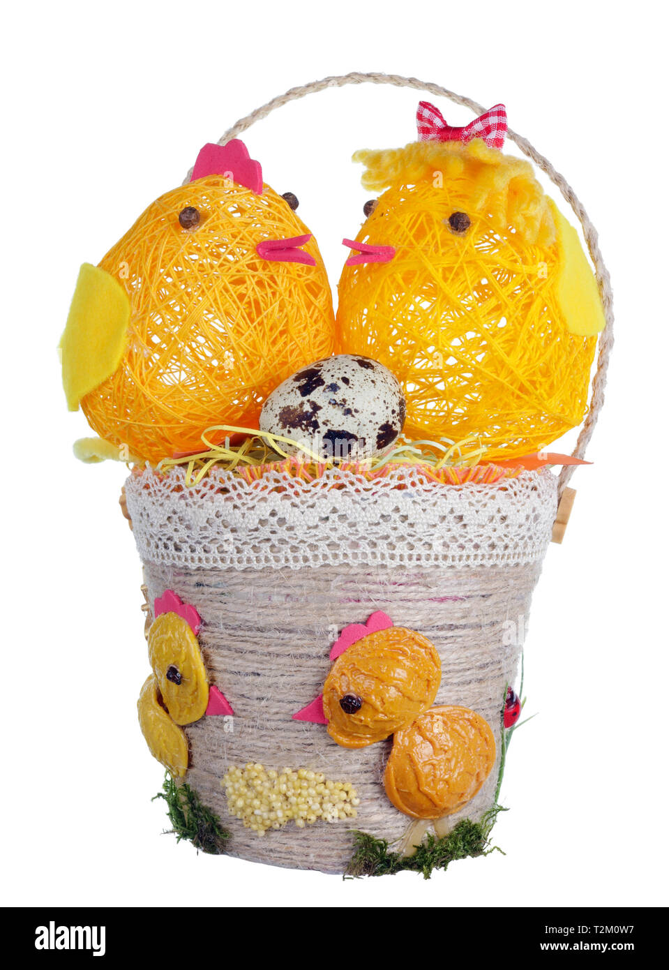 Easter handmade  basket  from rope and pasta  with funny chickens and guail egg. Isolated on white studio macro shot - Stock Image