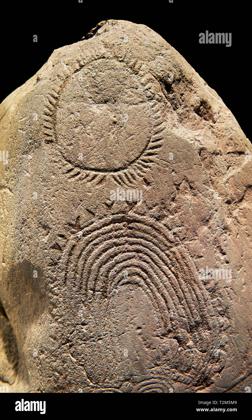 Prehistoric  petroglyphs, rock carvings, of geometric designs carved by  the prehistoric Camuni people, Museum of Prehistory in Val Camonica, Italy - Stock Image