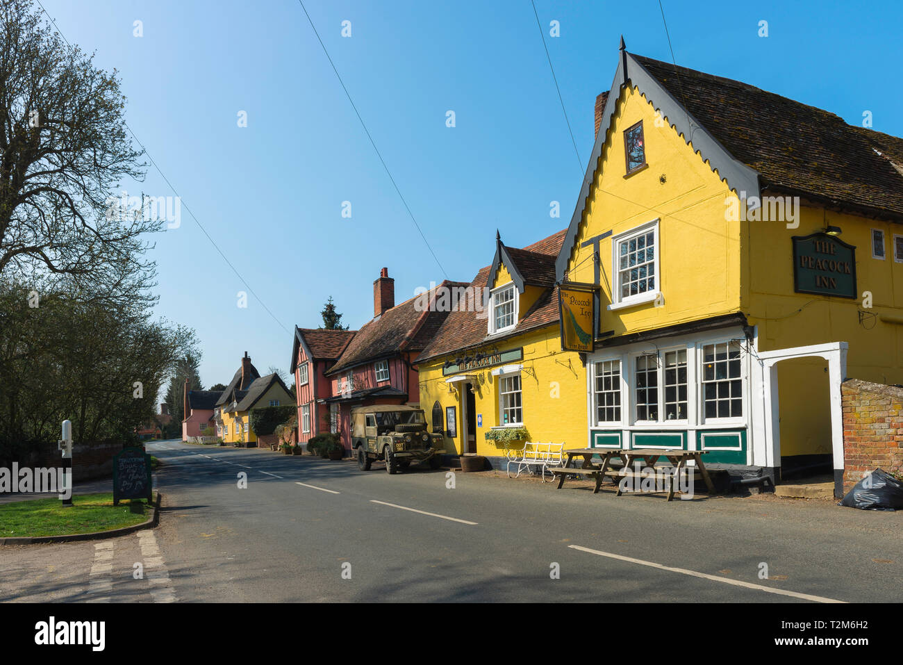 Chelsworth Suffolk, view of The Peacock Inn pub and colourful houses sited along The Street in the centre of the village of Chelsworth, Suffolk, UK - Stock Image