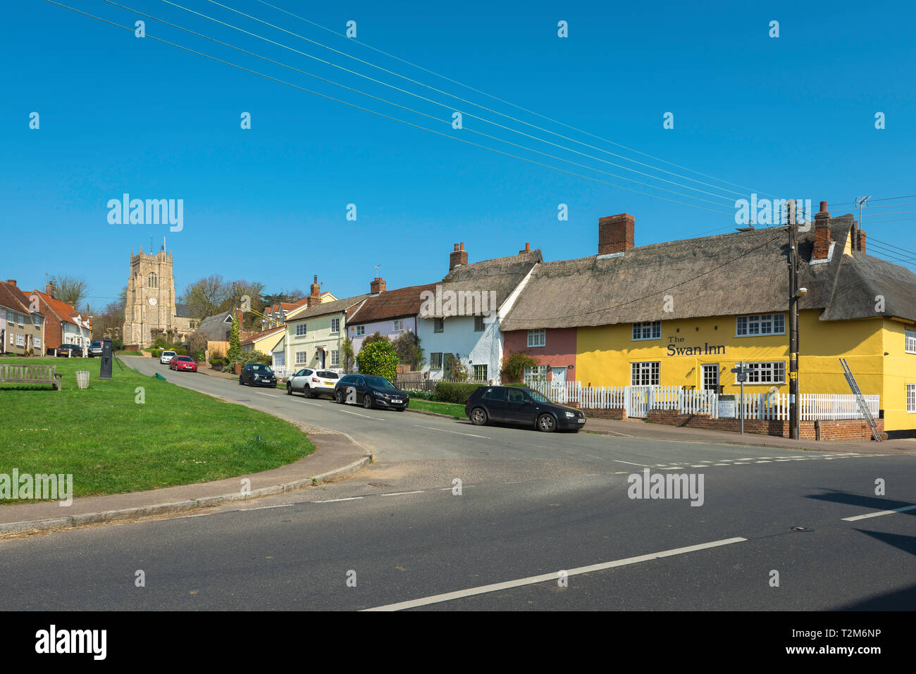 Monks Eleigh Suffolk, view across the village green towards Church Hill in Monks Eleigh, with the Swan Inn pub sited on the right, Babergh district,UK - Stock Image
