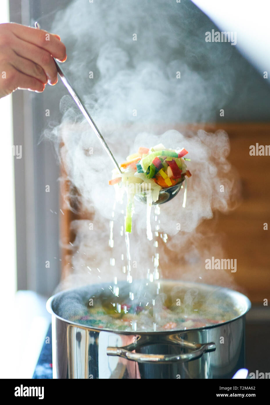 A hot vegetable soup is cooked and stirred in  Pfaffenhofen, April 28, 2019.  © Peter Schatz / Alamy Stock Photos - Stock Image