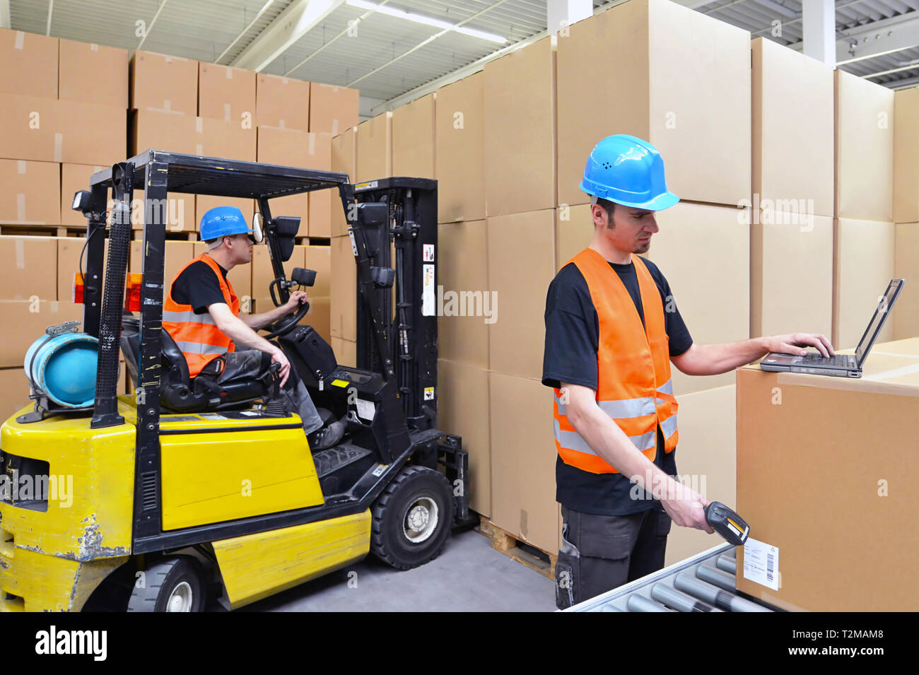 worker with notebook and barcode scanner handles a shipment in the