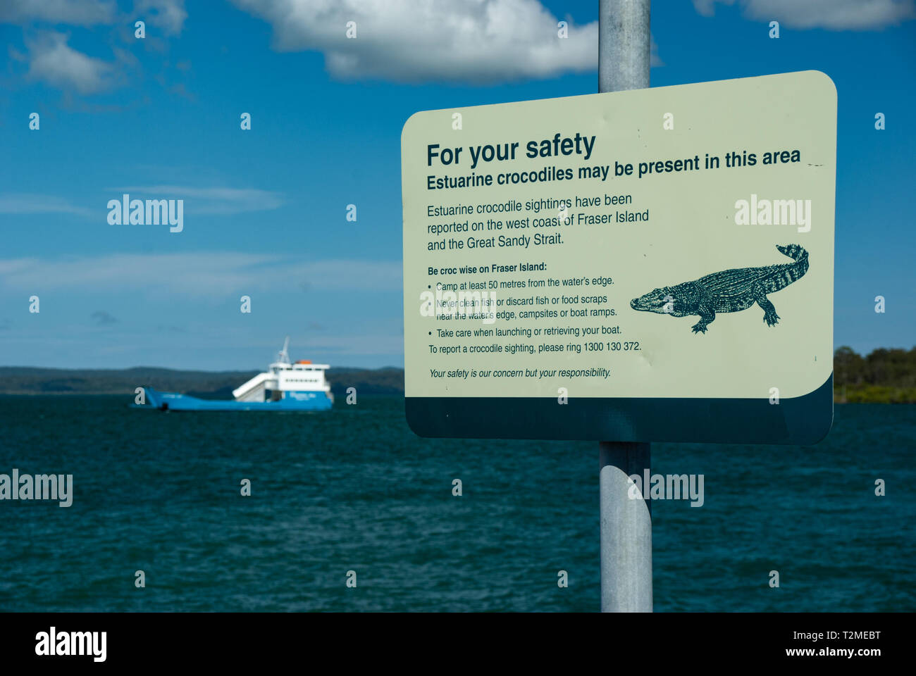 Crocodiles are a recent danger in the area of Fraser Island, therefore the government have placed signs to warn people of the risks. - Stock Image