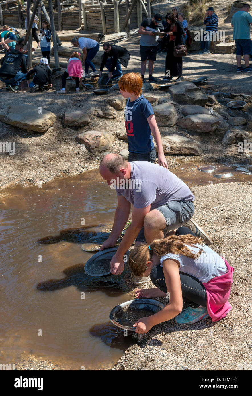 Family panning for gold at Sovereign Hill, an open air museum in the old gold mining town of Ballarat, Victoria, Australia - Stock Image