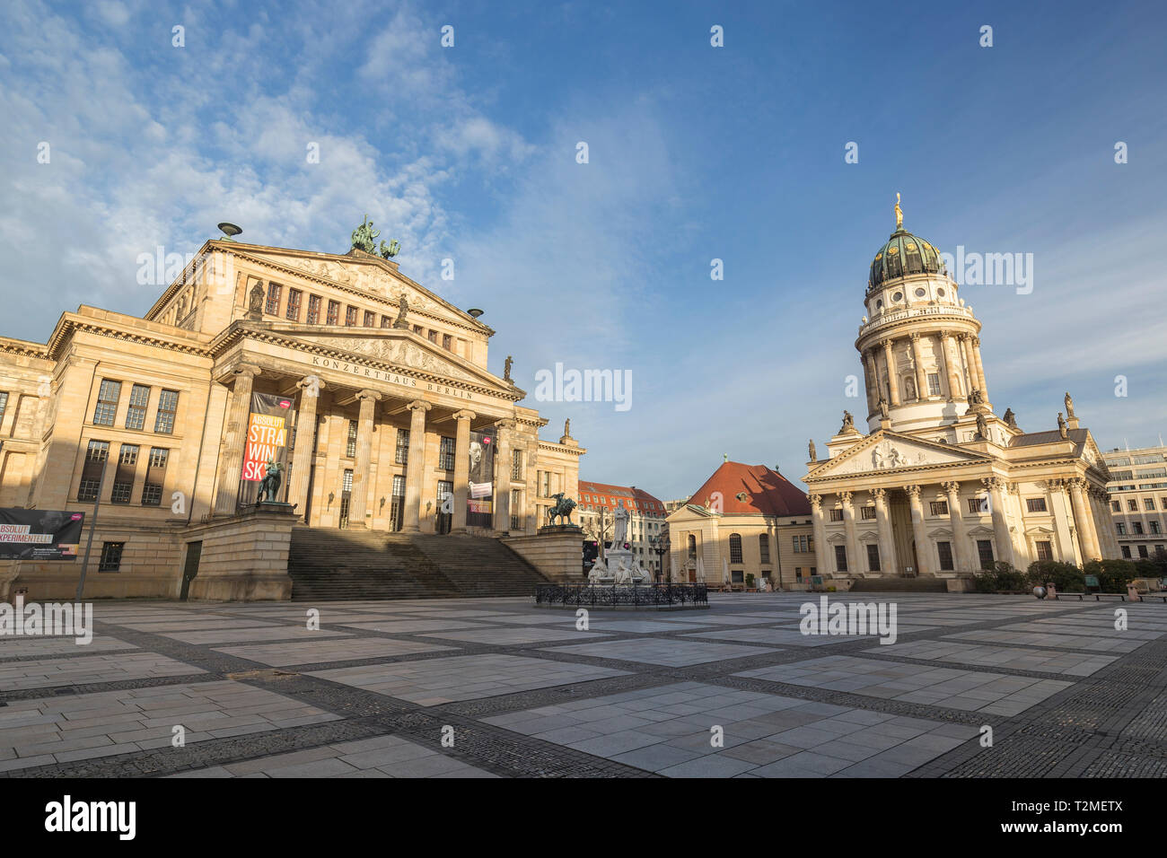 Konzerthaus Berlin (Berlin Concert Hall) and Französischer Dom (French Cathedral) at empty Gendarmenmarkt Square in Berlin, Germany, at sunny morning. Stock Photo