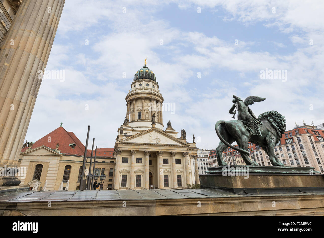 Französischer Dom (or the French Cathedral) and statue in front of the Konzerthaus Berlin (Berlin Concert Hall) at the Gendarmenmarkt Square in Berlin Stock Photo