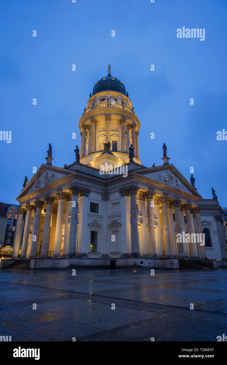 Lit Neue Kirche (Deutscher Dom, German Church or German Cathedral) in Berlin, Germany, at the Gendarmenmarkt Square in Berlin, Germany, in the evening Stock Photo