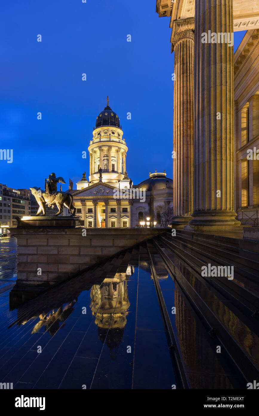 Lit Neue Kirche (Deutscher Dom, German Church or German Cathedral) and front of the Konzerthaus Berlin at the Gendarmenmarkt Square in Berlin at dusk. Stock Photo