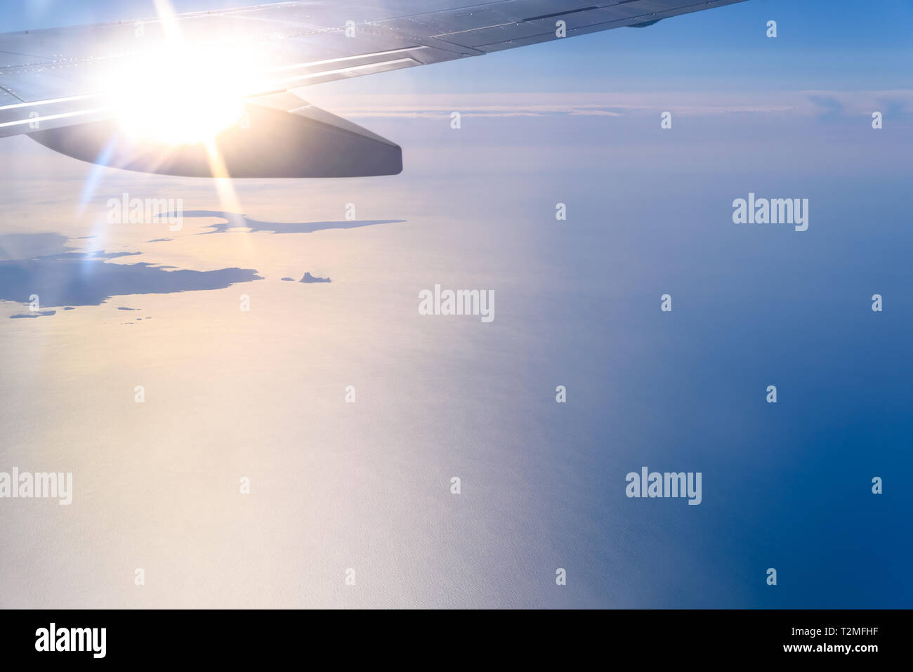 View of the sea from the window of an airplane. Stock Photo