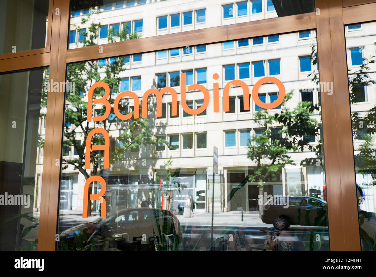 Exterior sign for Bar Bambino, a milk bar in Warsaw, Poland. - Stock Image
