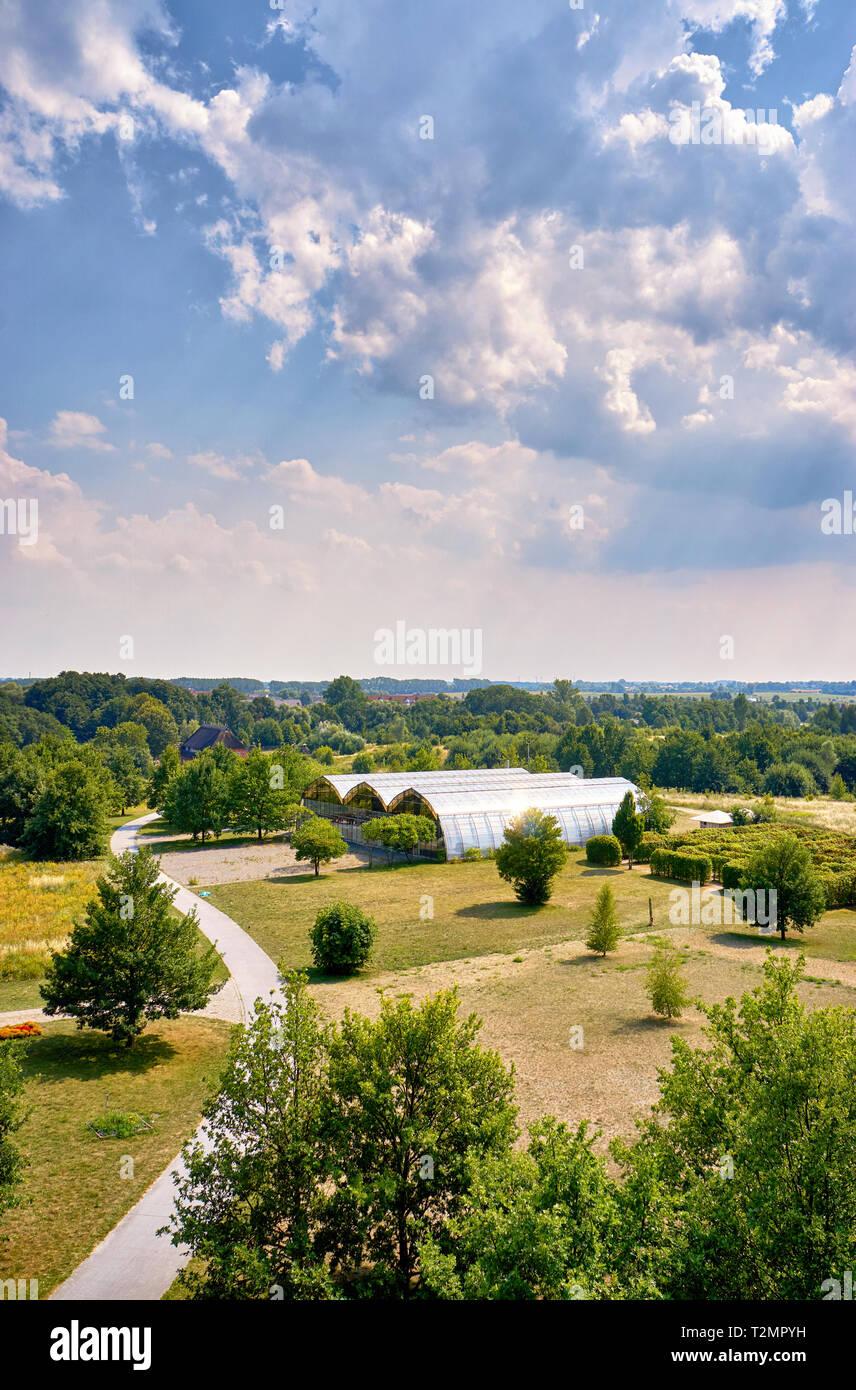 Park with modern large greenhouses in Wismar. Mecklenburg-Vorpommern, Germany - Stock Image