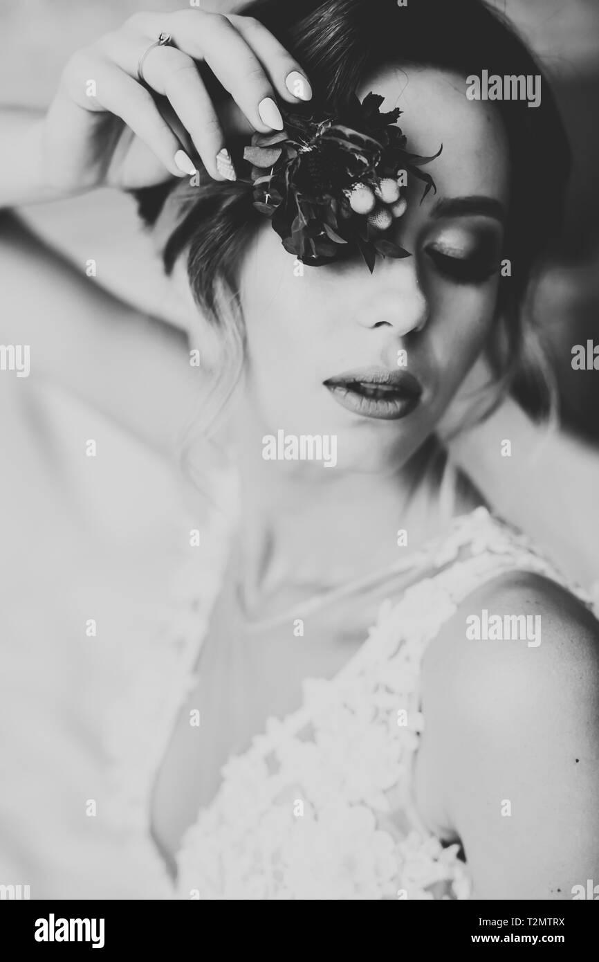 Beautiful luxury bride in elegant white dress. - Stock Image