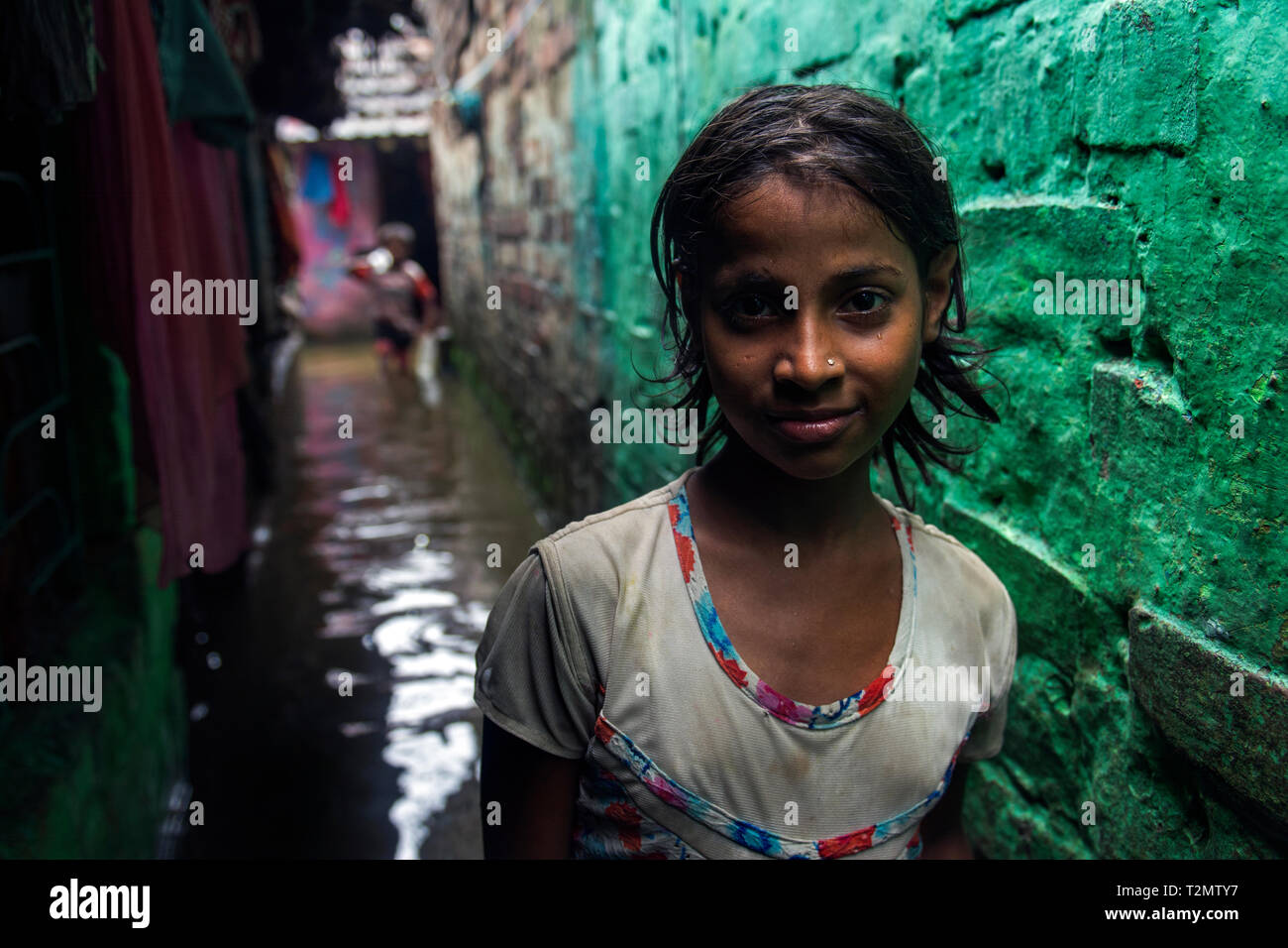 I took this picture few years ago in a narrow alley of Howrah, after a heavy rainfall. Their waterlogged condition was terrible to describe. Stock Photo
