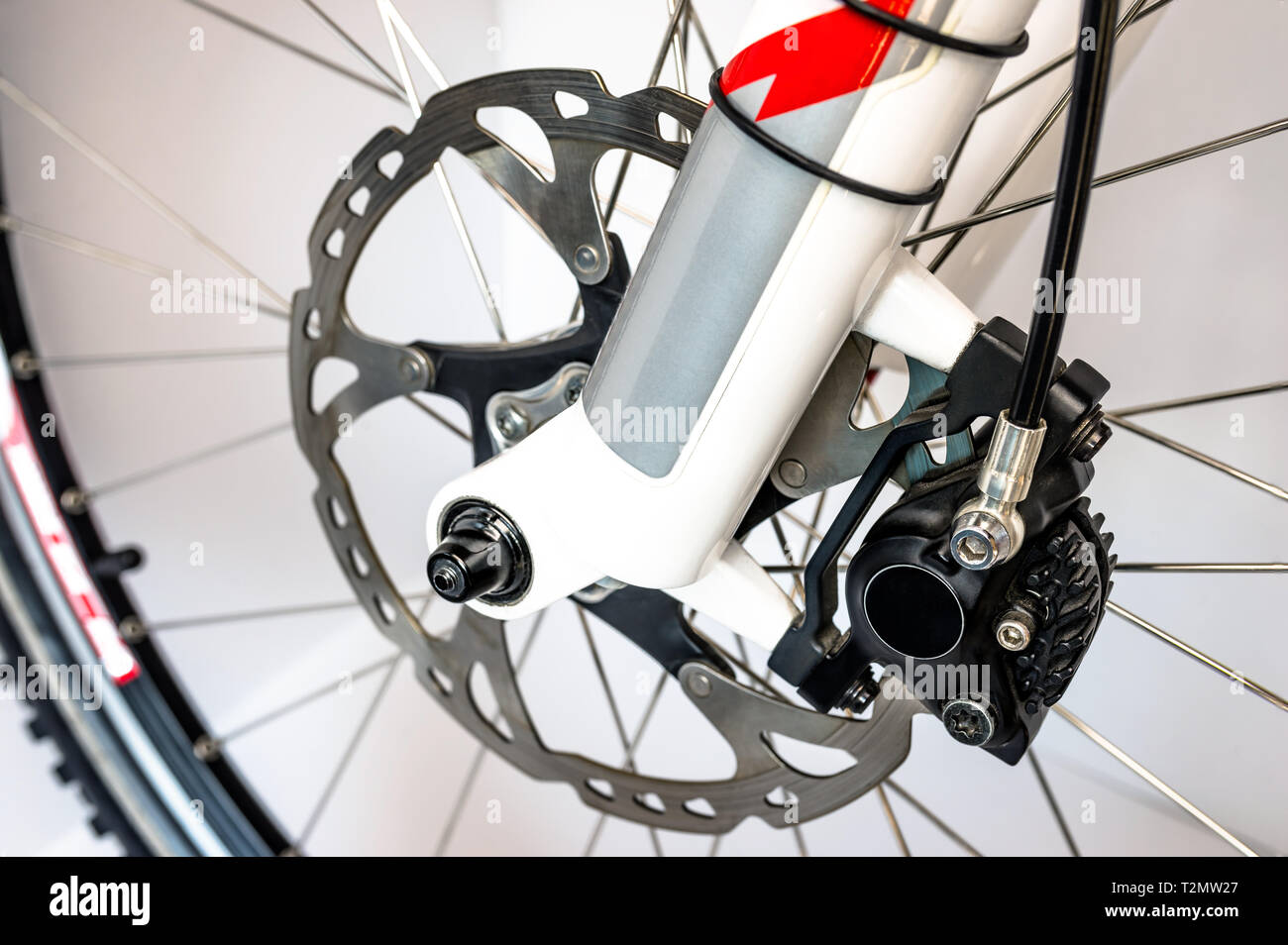 Hydraulic front disc brake on mountain bike. Isolated on a white background. High resolution, full frame. Stock Photo