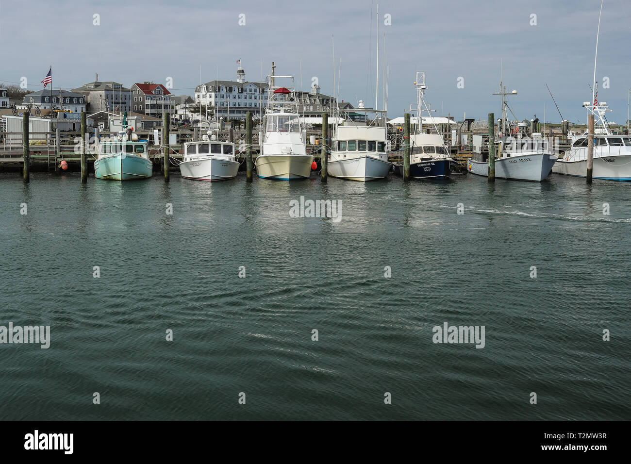 Boats at mooring, hotels in background. Block Island Rhode Island, USA. fishing and pleasure boats dot the shoreline at Old Harbor, Block Island, RI - Stock Image
