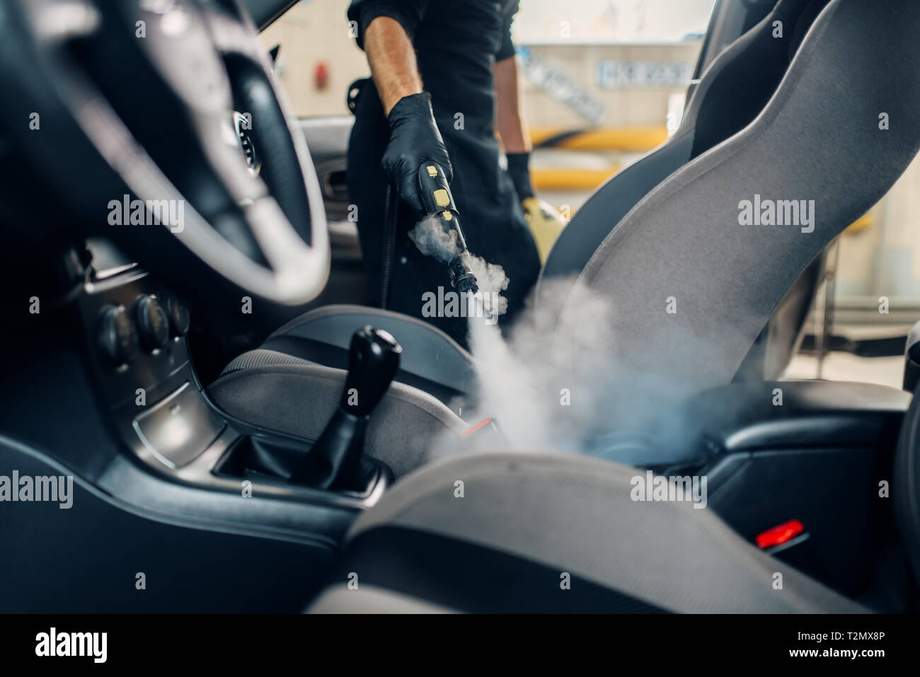Steam Clean Car Interior >> Carwash Service Male Worker In Gloves Cleans Seats With