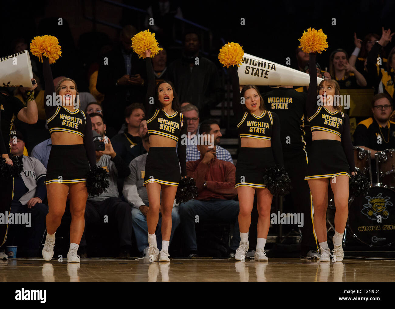April 02, 2019: The Wichita State Shockers cheerleaders root on their team at the semi-final of the NIT Tournament game between The Wichita State Shockers and The Lipscomb Bisons at Madison Square Garden, New York, New York. The Lipscomb Bisons defeat The Wichita State Shockers 71-64. Mandatory credit: Kostas Lymperopoulos/CSM - Stock Image