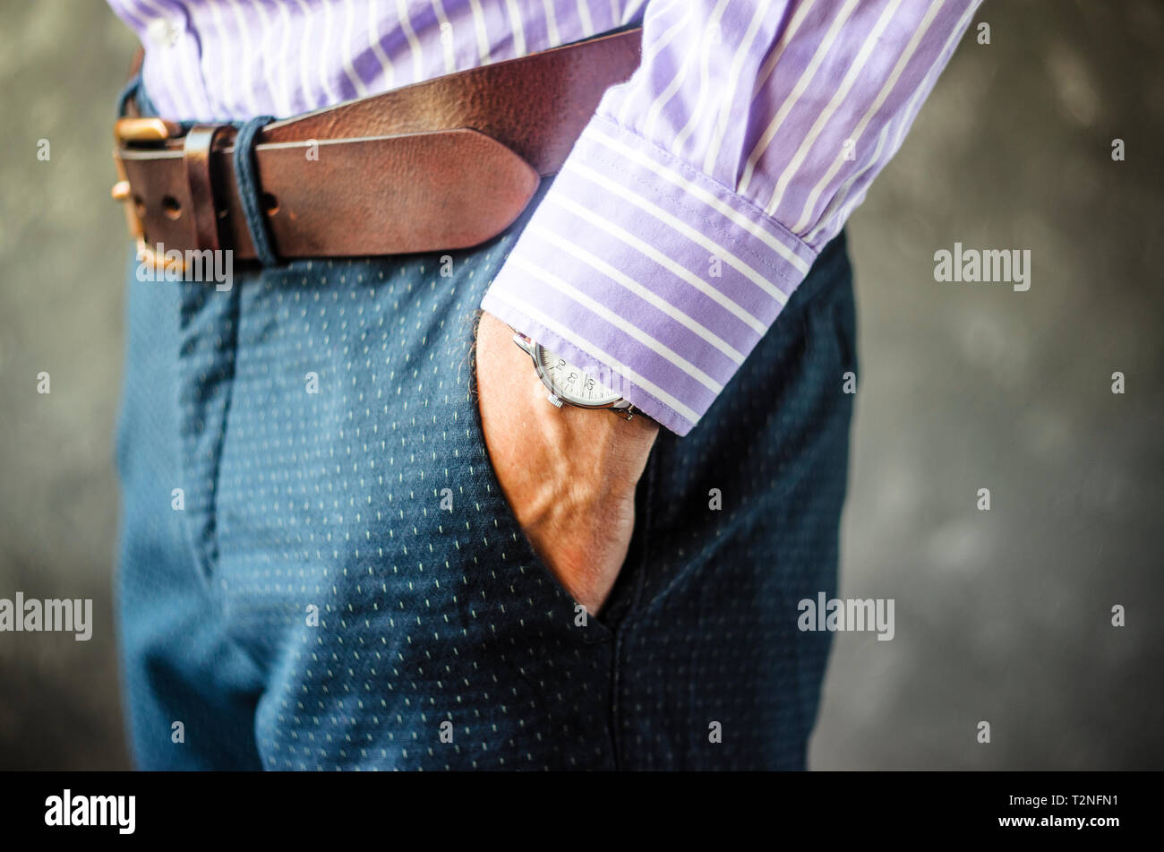 Close Up of Man Hand with Wrist Watch in the Pocket of