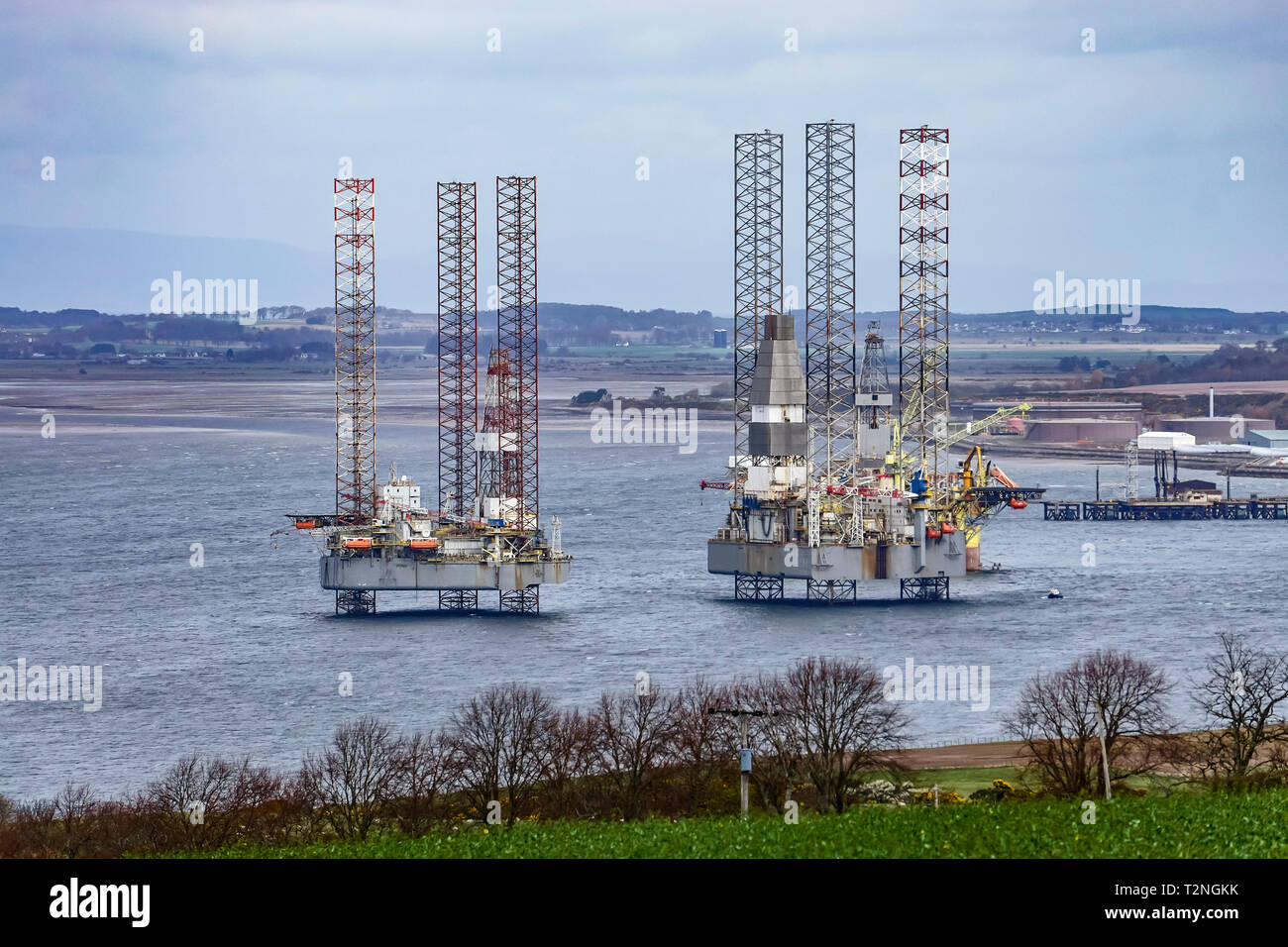 Moored platforms FON and Baug in Cromarty Firth near Cromarty Black Isle Highland Scotland UK - Stock Image