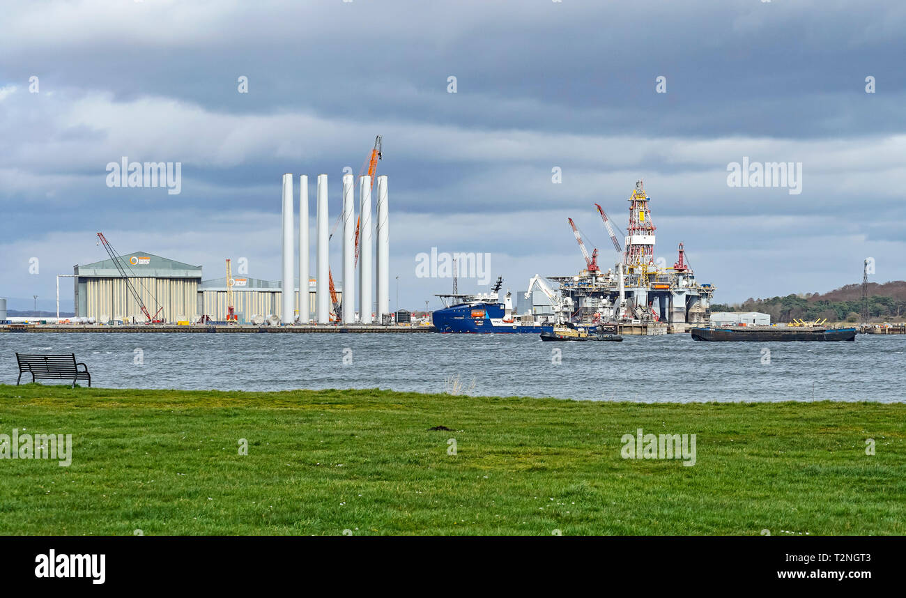 Global Energy at Nigg Energy Park Port of Nigg Highland Scotland UK viewed from Cromarty on the Black Isle with rig and vessel Topaz Tiamat - Stock Image