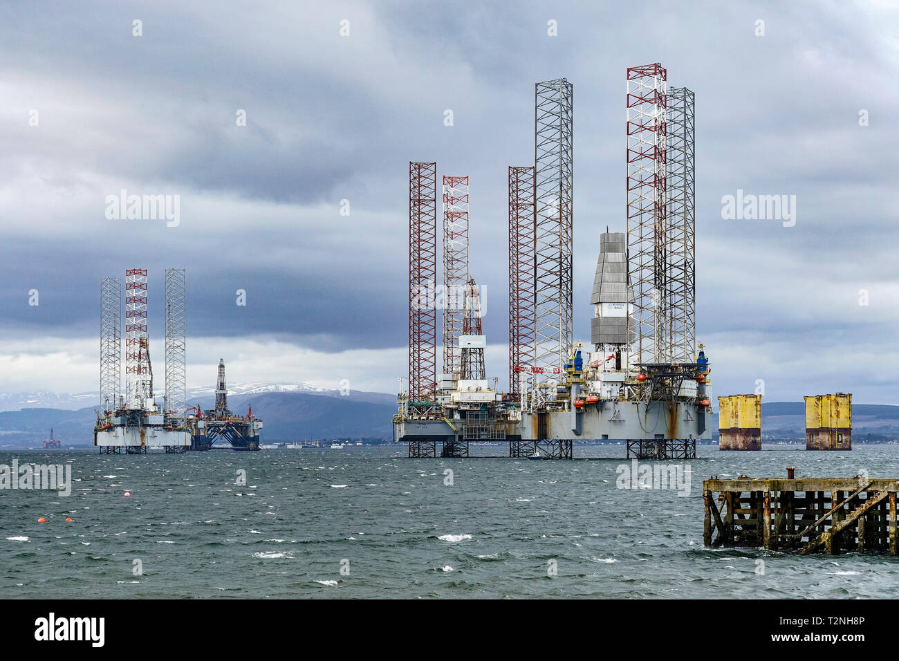 Moored platforms in Cromarty Firth near Cromarty Black Isle Highland Scotland UK with Fonn and Baug right - Stock Image