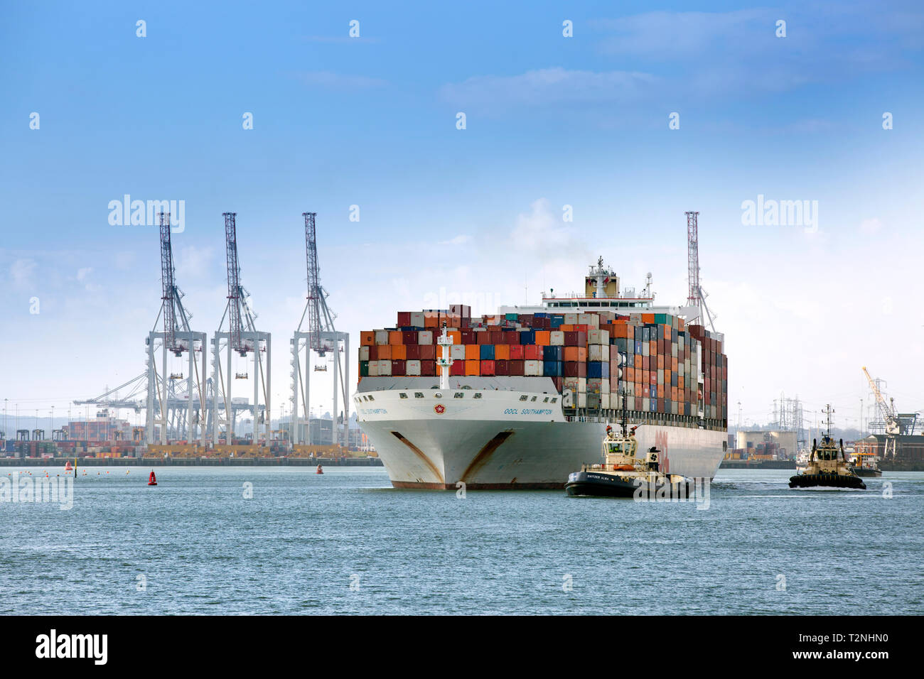 Container ship carrying export goods leaving Southampton Docks - Stock Image