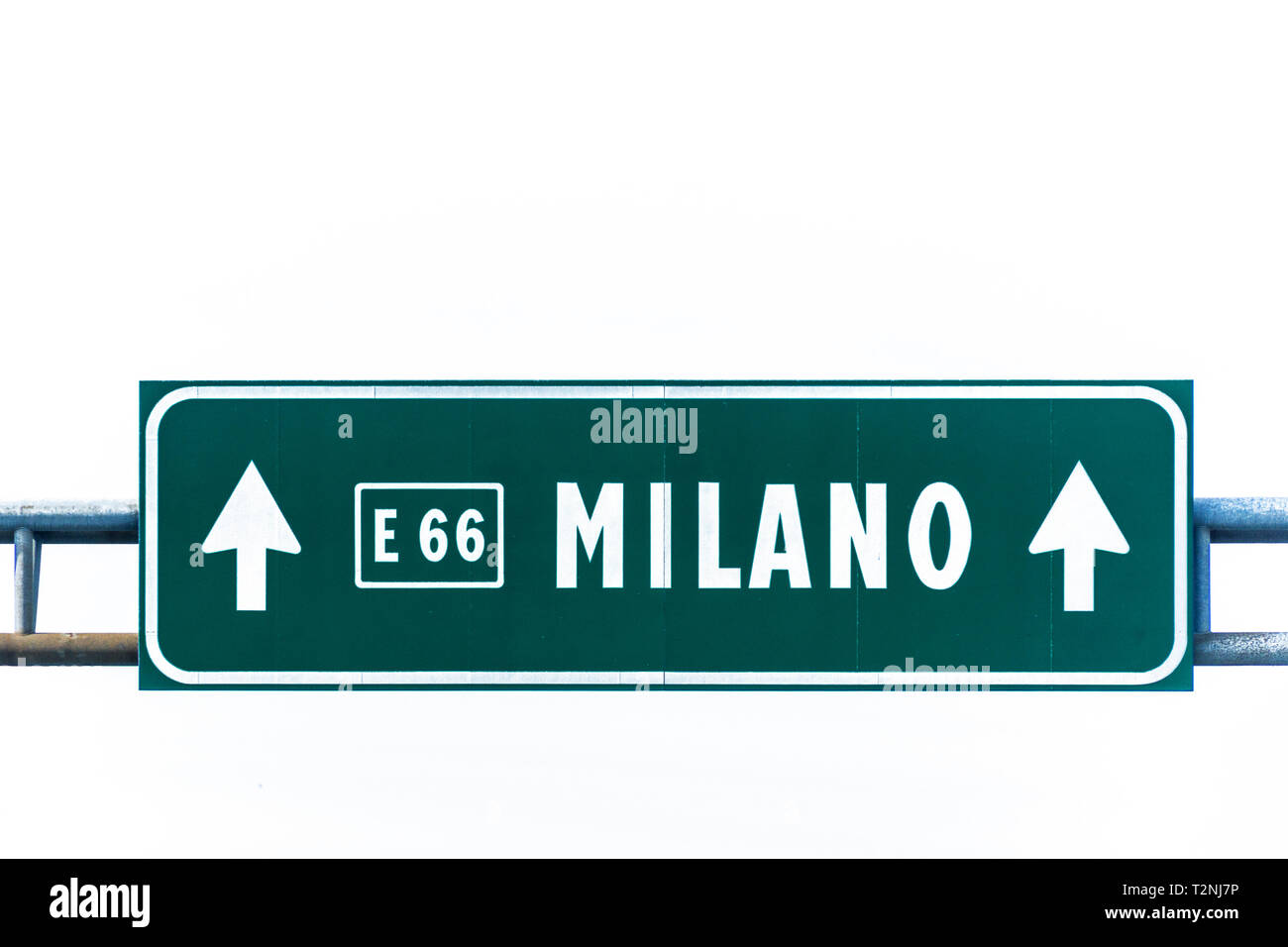 Green highway sign to Milano isolated on white. - Stock Image